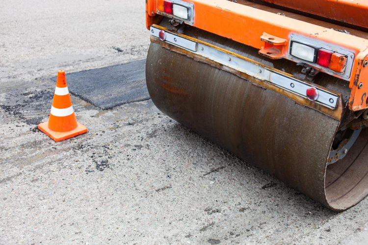 This is a picture of an asphalt and concrete repair.